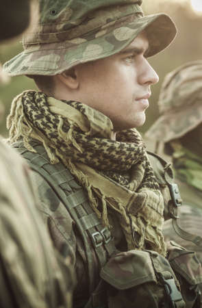rigor: Soldier in a military clothes standing to attention and looking straight ahead Stock Photo