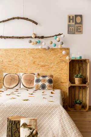 lightsome: Part of lightsome calm bedroom with wooden decor and comfortable double bed Stock Photo