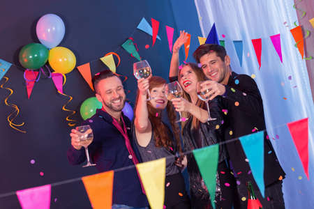 Elegant happy young people celebrating new year's eve on a party Stock Photo