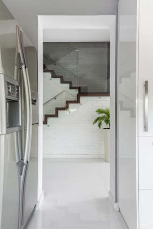 steely: Entrance to kitchen with stainless steel refrigerator from the staircase