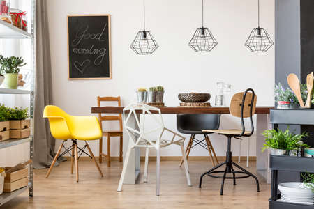 communal: Communal table in bright and spacious dining room Stock Photo