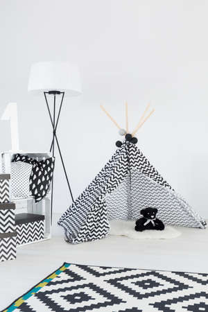 Bright baby room interior with teepee