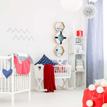 unisex: Unisex nursery with wooden cradle and colourful decorations