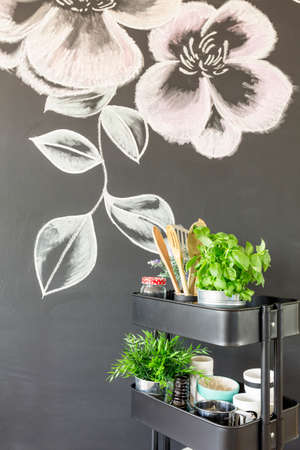 chalky: Chalky flowers drawing on the dining room wall Stock Photo