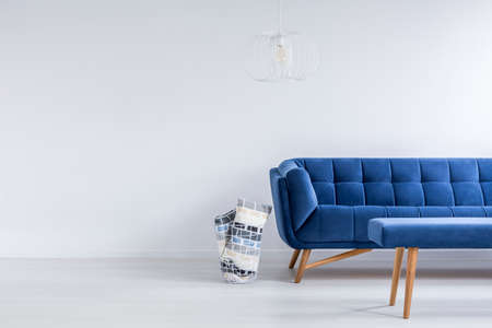 ascetic: Ascetic living room in white with blue sofa and bench