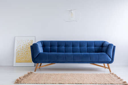 Simple White Room With Blue Sofa And Rug Stock Photo   71340105