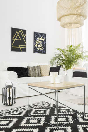 Bright living room with white, sofa and pattern carpet Stock Photo