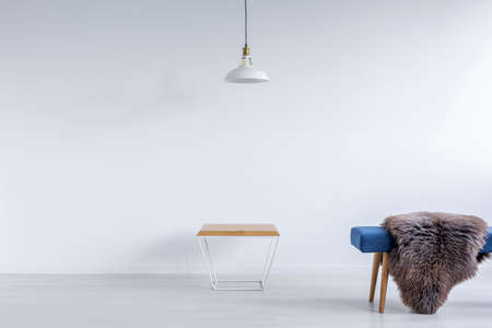 ascetic: White ascetic room with blue bench, small table and lamp