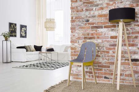 living room wall: Trendy loft with brick wall and white living room