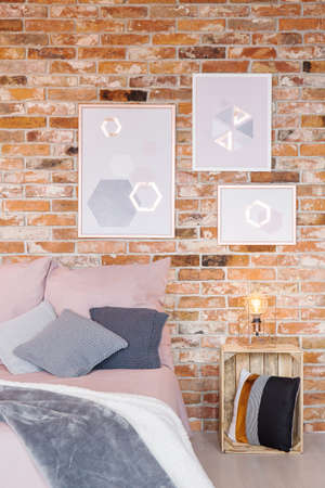 bedside: Trendy bedroom with crate bedside table and wall decoration