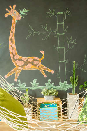 Modern kid room with blackboard and hammock