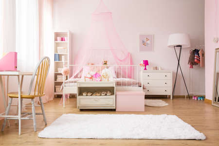 Multifunctional girl room with bed, rug, chair and desk