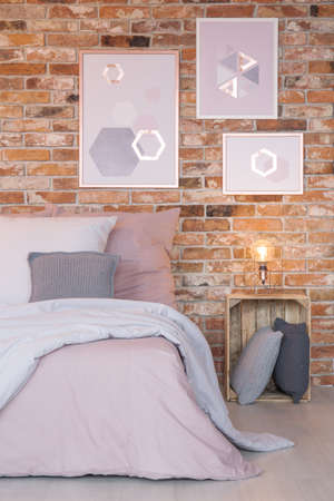 nightstand: Bedroom with modern wall decoration, bed and crate nightstand