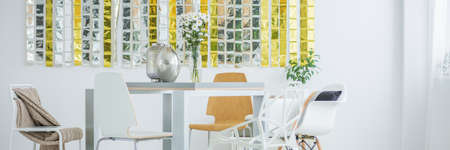 communal: Communal table in bright room interior Stock Photo