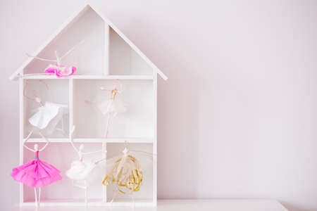 dollhouse: Pink room with decorative wood house shelf and ballerina dolls
