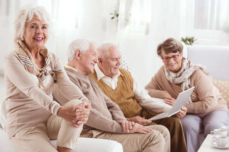 neighborly: Group of elderly people recalling old times together Stock Photo