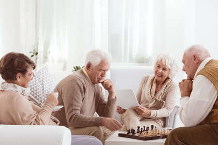 Group of senior friends spending active time together Stock Photo - 71490308