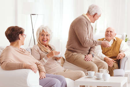 Senior people in nursing home spending time with friends