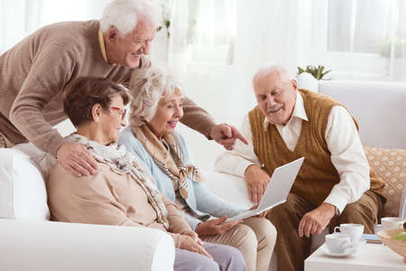 Group of elderly people using new technology in nursing home