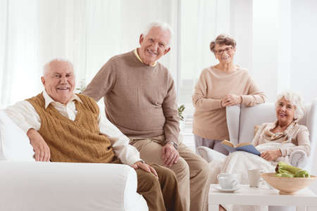 neighborly: Happy elderly group of people in nursing home Stock Photo