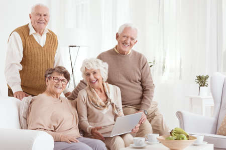 neighborly: Group of happy senior friends spending time together