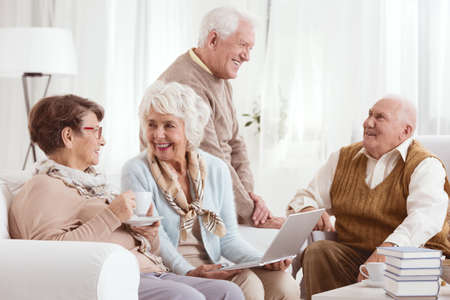 neighborly: Old friends hanging out together in retirement club Stock Photo