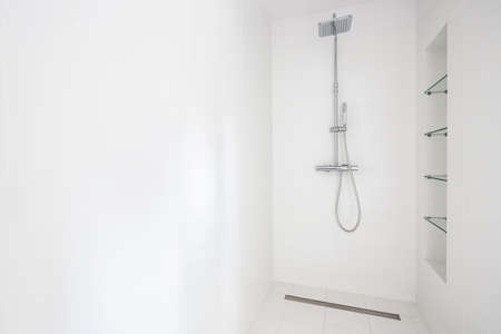 interior spaces: Douche with silver shower head and stransparent shelves Stock Photo