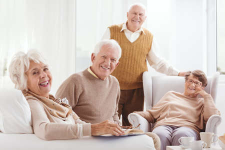 neighborly: Group of older and happy people spending time together
