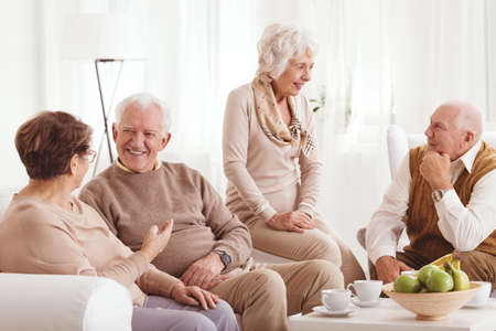 neighborly: Group of older happy friends and meeting after years