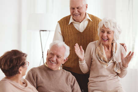 neighborly: Happy senior old friends on a reunion at retirement club Stock Photo