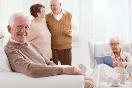 neighborly: Group of seniors spending active time together in retirement club