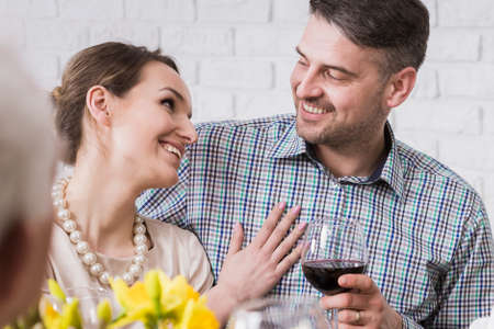 anecdote: Young married couple smiling during dinner with wine Stock Photo