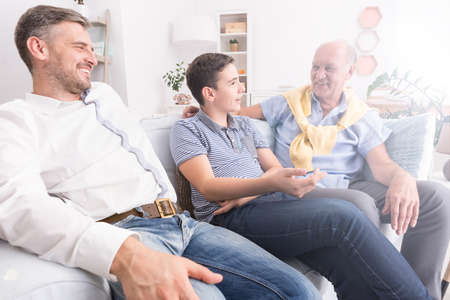 casual men: Fathers Day celebration at home area