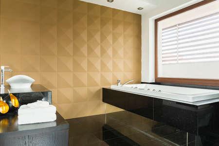bathroom wall: Luxurious bathroom with caramel 3d wall and bathtub on legs Stock Photo