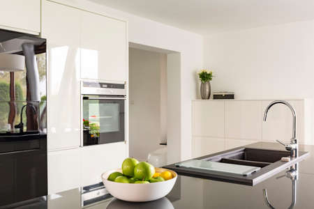White Gloss Kitchen With Black Worktops on black with white drawers, black with white doors, black with white kitchen floor,