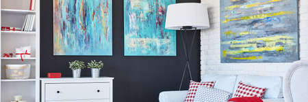 living room furniture: Colorful cozy living room with black wall ad white furniture Stock Photo
