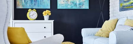 living room furniture: Small cozy living room with black wall and white furniture
