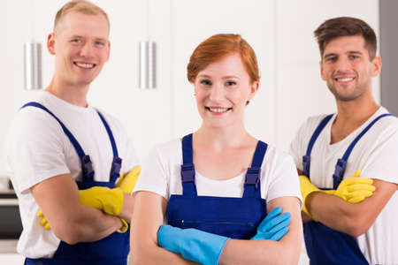 smiled: Satisfied and smiled team of cleaners in dungarees