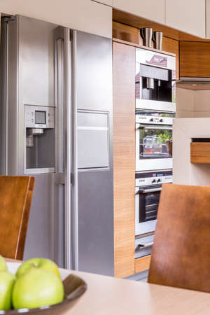double oven: Vertical view of refrigerator in the kitchen