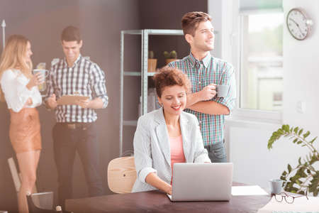 atmosphere: Young creative businesspeople having fun at work in the office Stock Photo