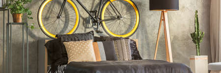 kingsize: King-size bed in modern bedroom decorated with bicycle Stock Photo