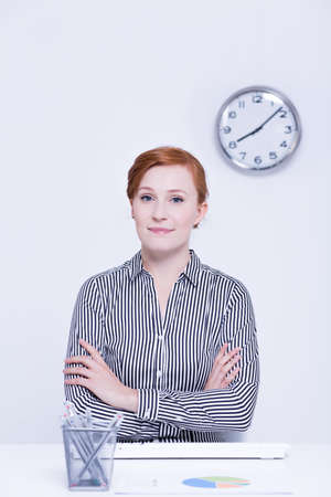 selfcontrol: Confident corporate female worker at her desk Stock Photo