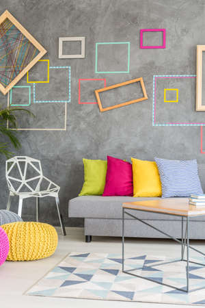 living room wall: Colorful living room with frames on the wall