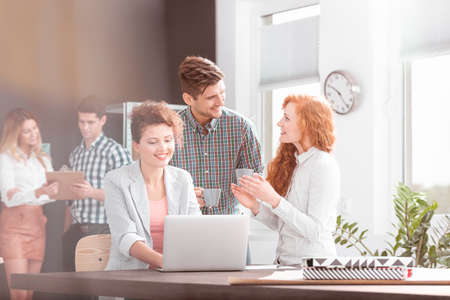 businesspeople: Young happy businesspeople in the morning in the office