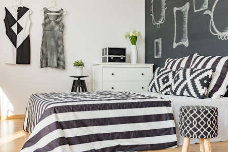 kingsize: Black and white king-size bed in stylish modern bedroom Stock Photo