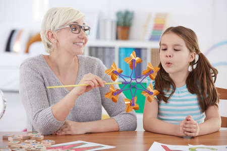 Specialist using funny speech therapy activities for children
