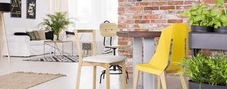 white interior: Spacious modern loft with brick wall, plants and big sofa Stock Photo