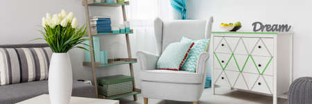 Comfortable armchair in a cosy living room in light colours Stock Photo