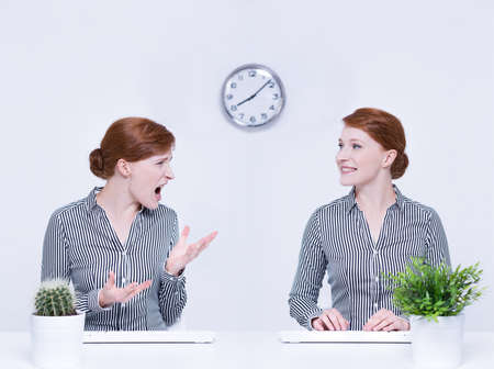 Anger and self-control of female employee in office Stock Photo