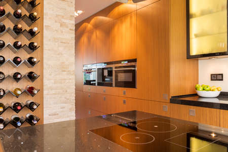 Spacious modern kitchen with wooden units and space for wine Stock Photo